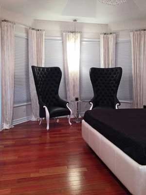 Bedroom with White Curtains, Black Chairs